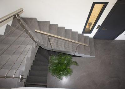 Réalisation d'escaliers en béton spatulé